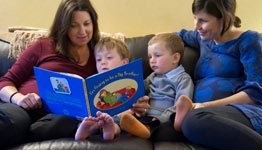 A family reading 'I'm Going to be a Big Brother'