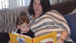 A mother and her daughter reading 'I'm Going to be a Big Sister'